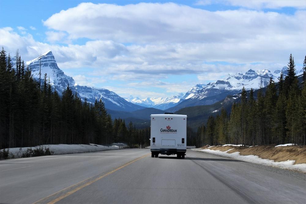 white box truck running on road