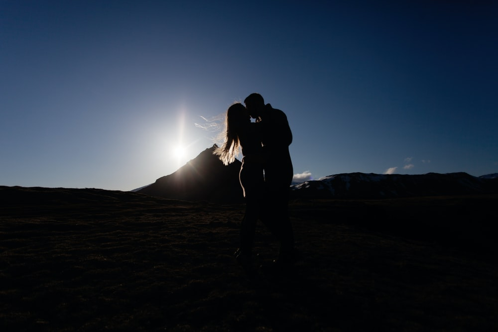 silhouette photography of man and woman