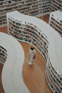 woman standing on bookstore