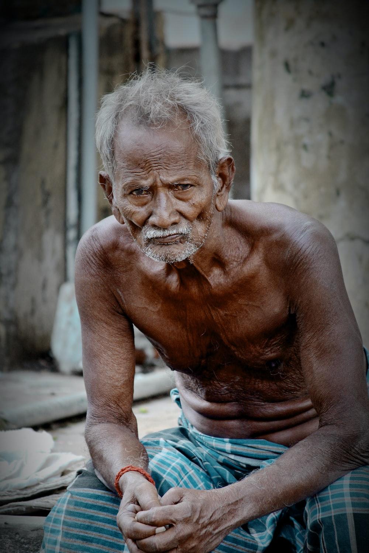 man sitting wearing sarong