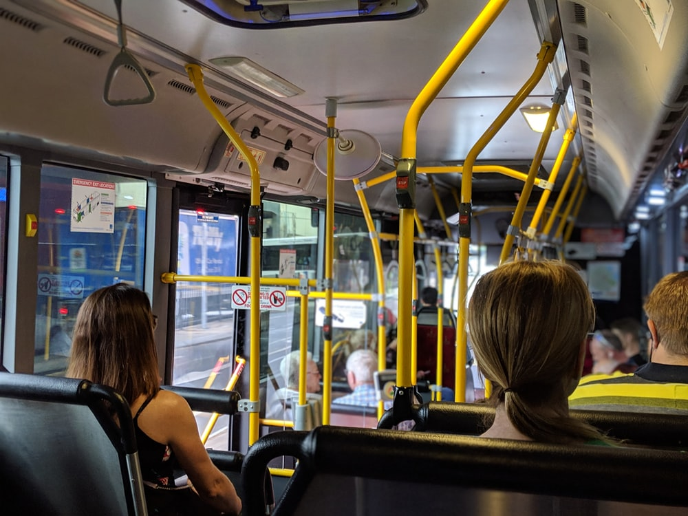 people sitting down inside vehicle
