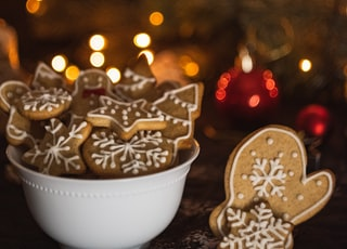 cookies in bowl near Christmas tree