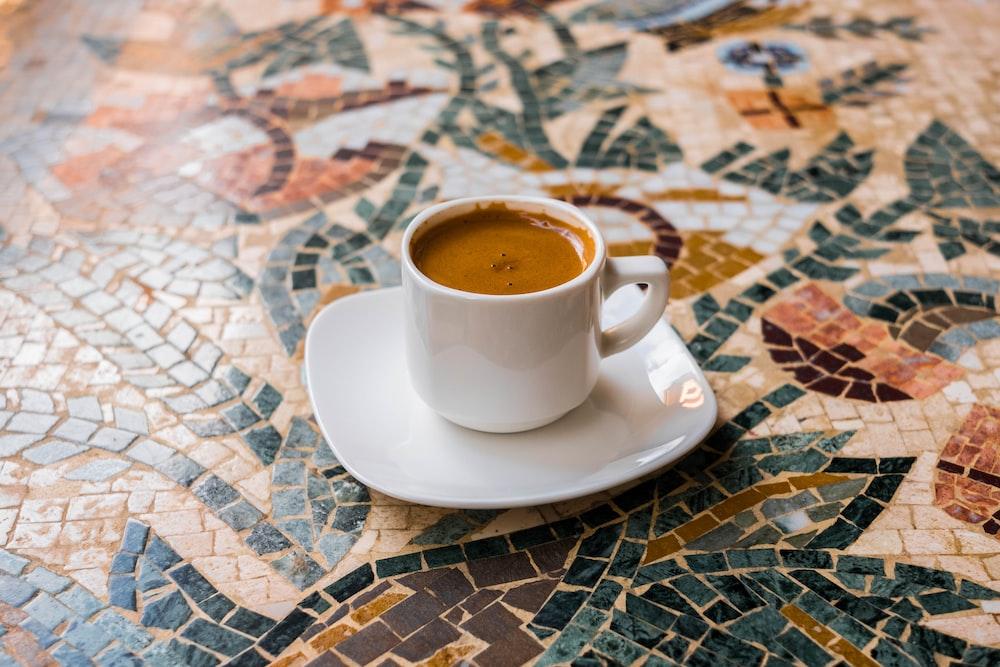 ceramic teacup with lattte