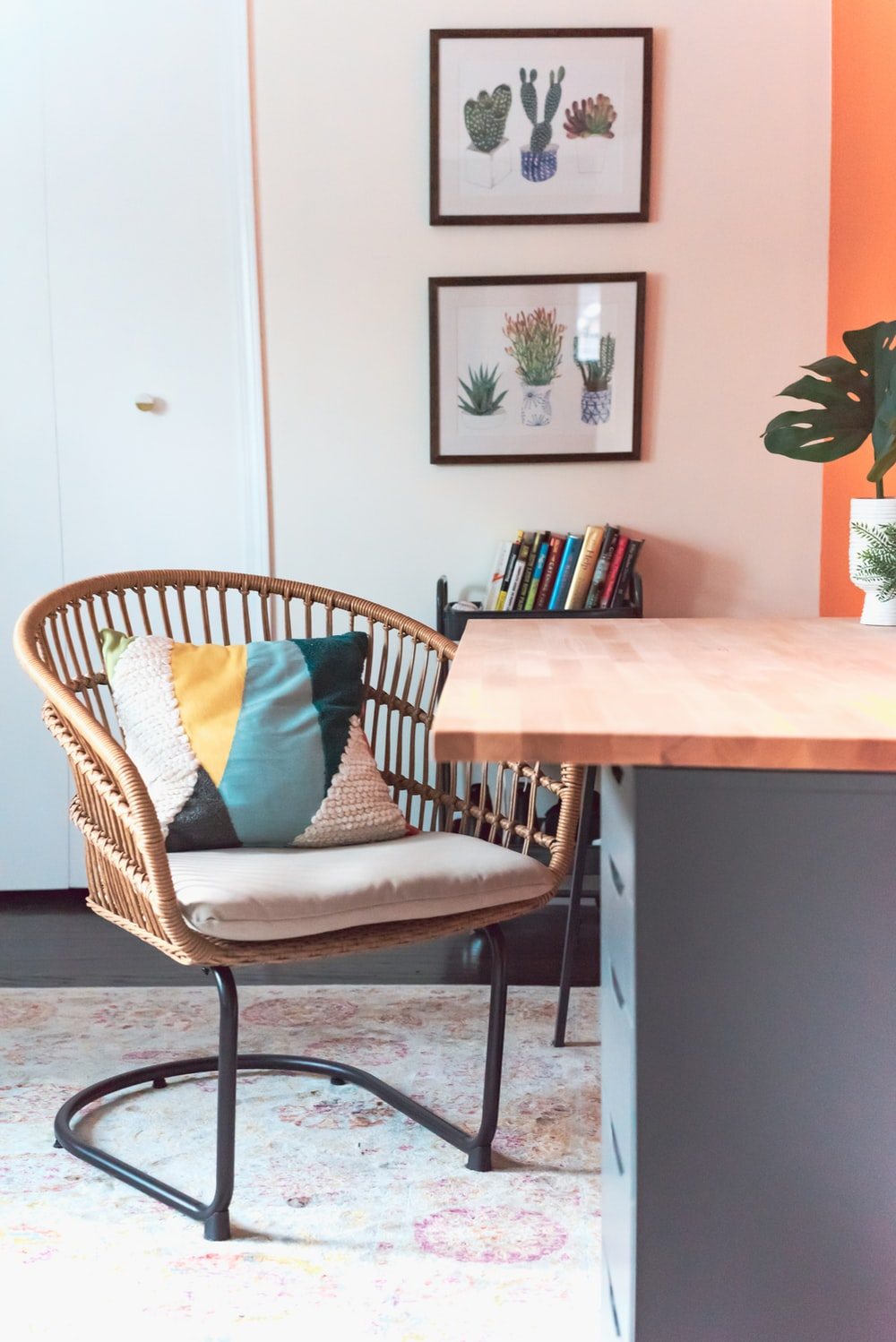 cantilever chair with throw pillow near table
