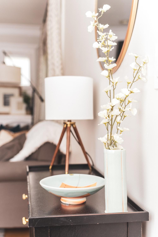 white ceramic bowl on cabinet