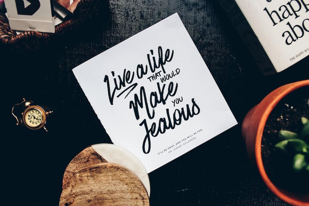 live a life make jealous signage