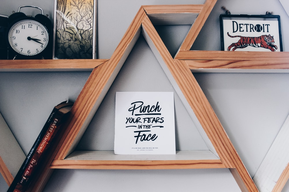 Punch your fears in the Face poster in wall shelf
