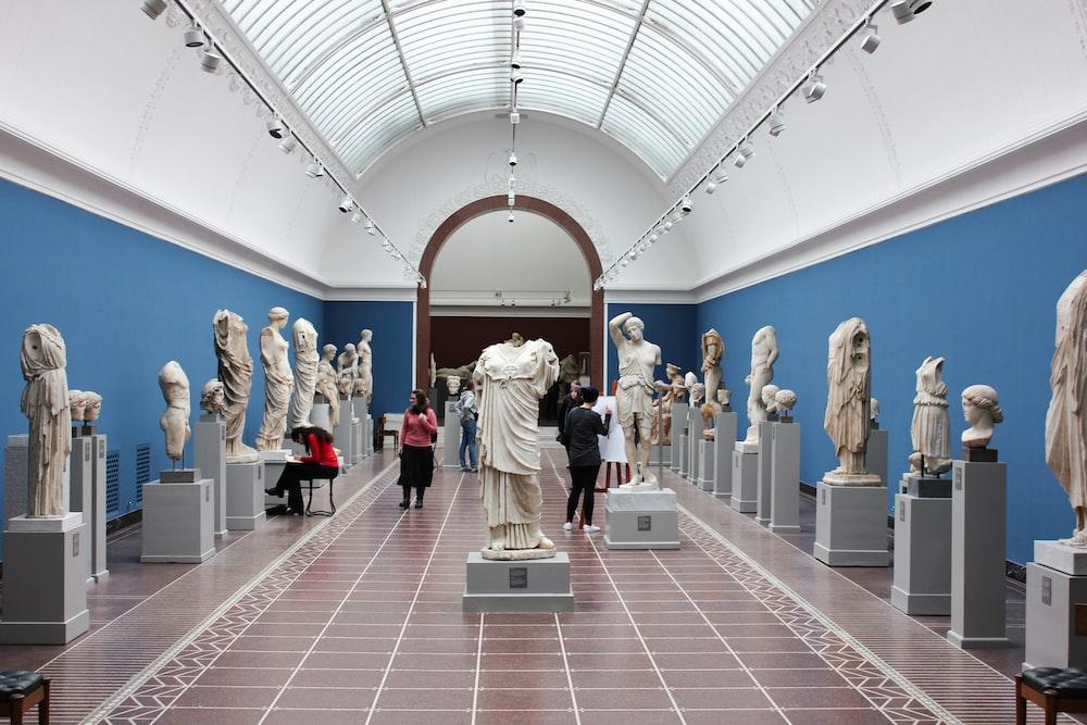 people watching statue in gallery room