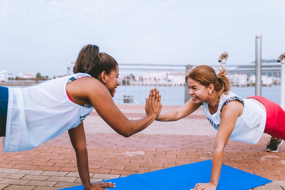 two women doing push up