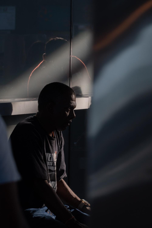 man in black shirt sitting