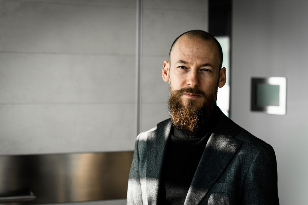 man wearing black blazer