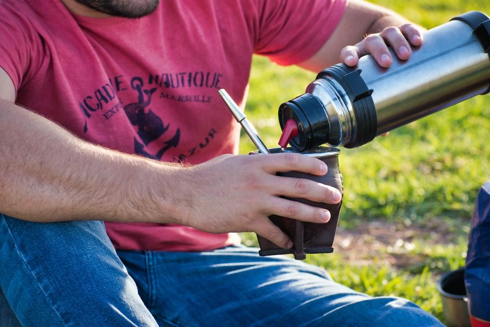 man pouring on mug