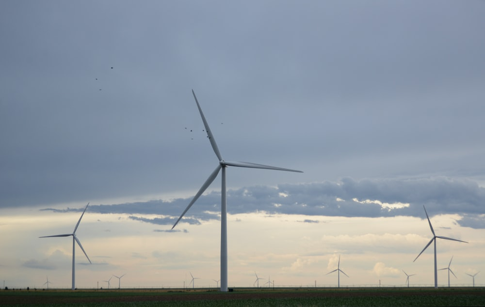 white wind mill during daytime