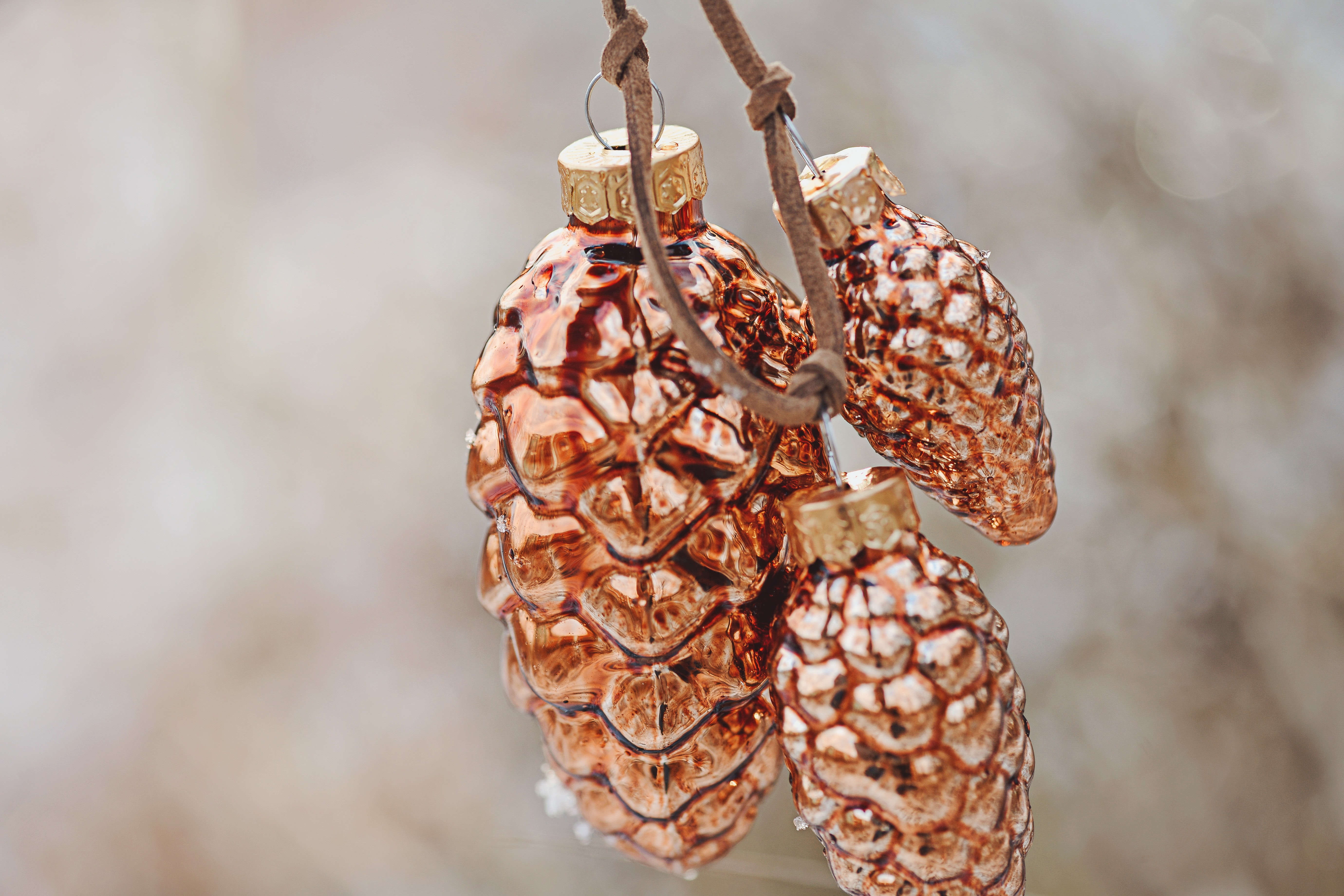 tilt shift photography of three brown ceramic ornaments