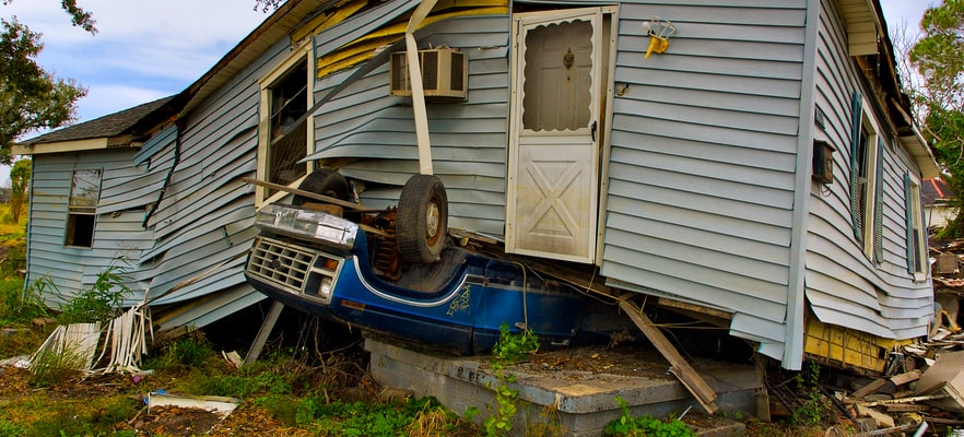A mobile home affected by a natural disaster set upon a truck