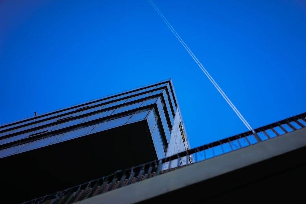 jet vapor streaming on clear blue sky