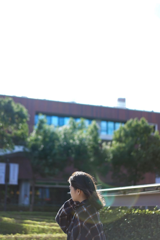 woman beside grass