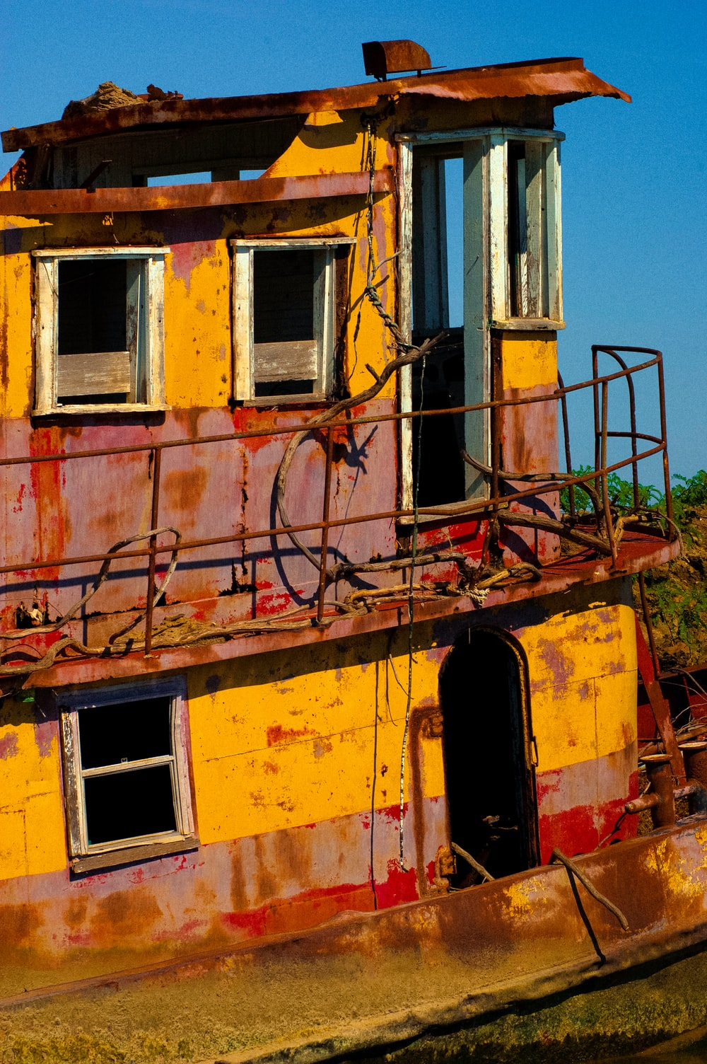 yellow and red 2-decker boat