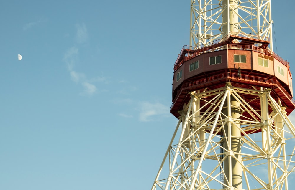 close-up photo of white and red tower