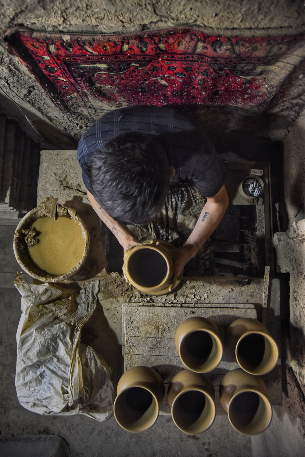 man making pots on top view