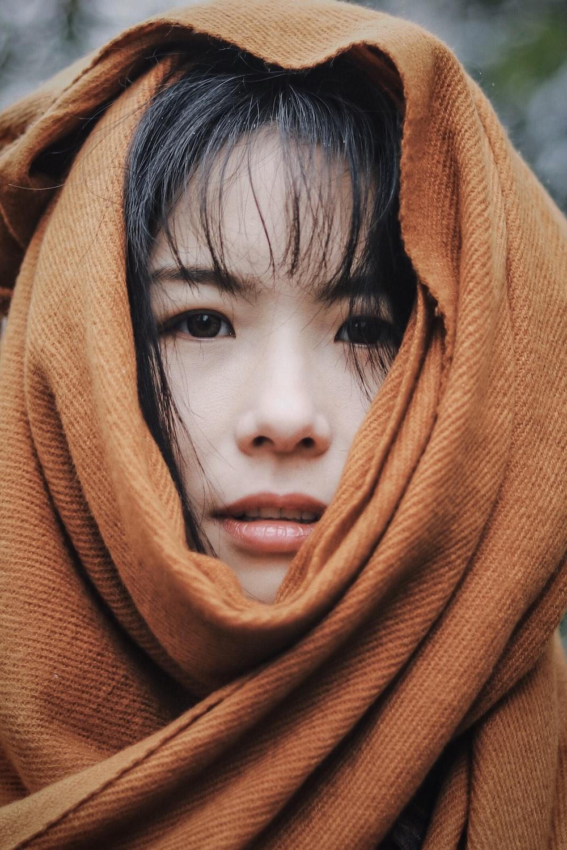 women's orange hijab headdress