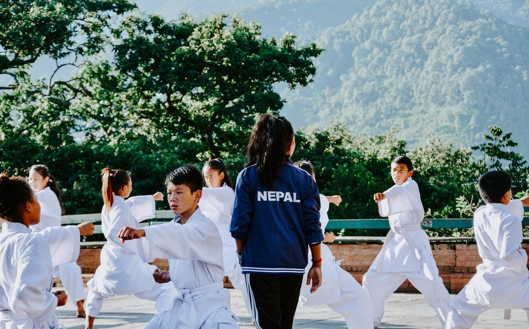 Children practicing Taekwondo in Kathmandu, Nepal. I can feel  the persistence of the children and dedication of the instructor.  Added tag for International Women's Day 2019.