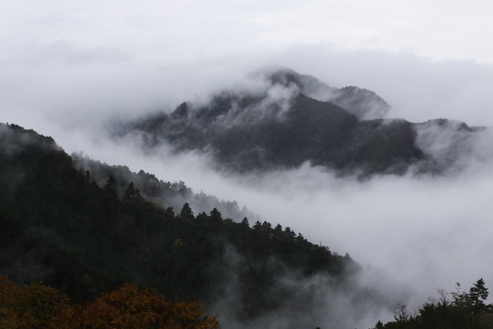 mountain cover with white clouds