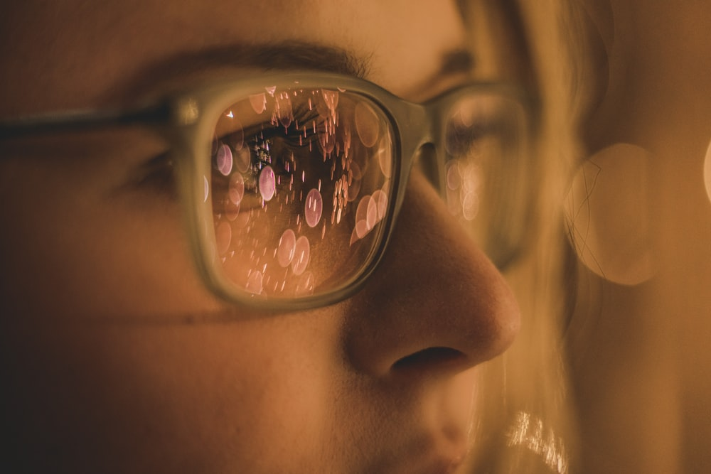 woman wearing eyeglasses in close-up photo