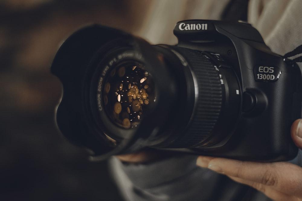 black Canon EOS 1300D DSLR camera