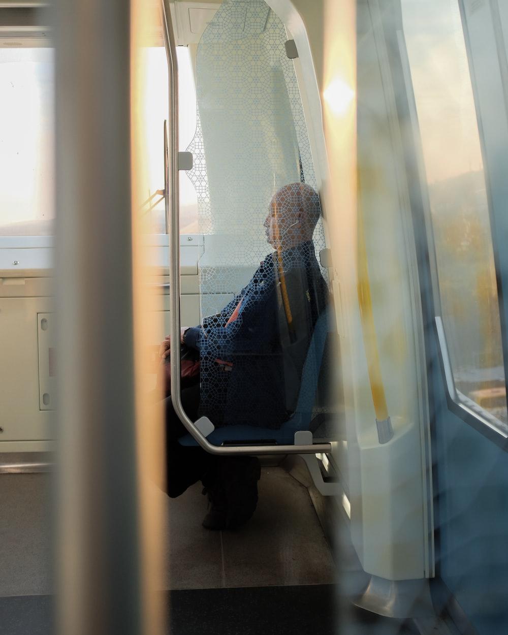 man sitting on vehicle seat