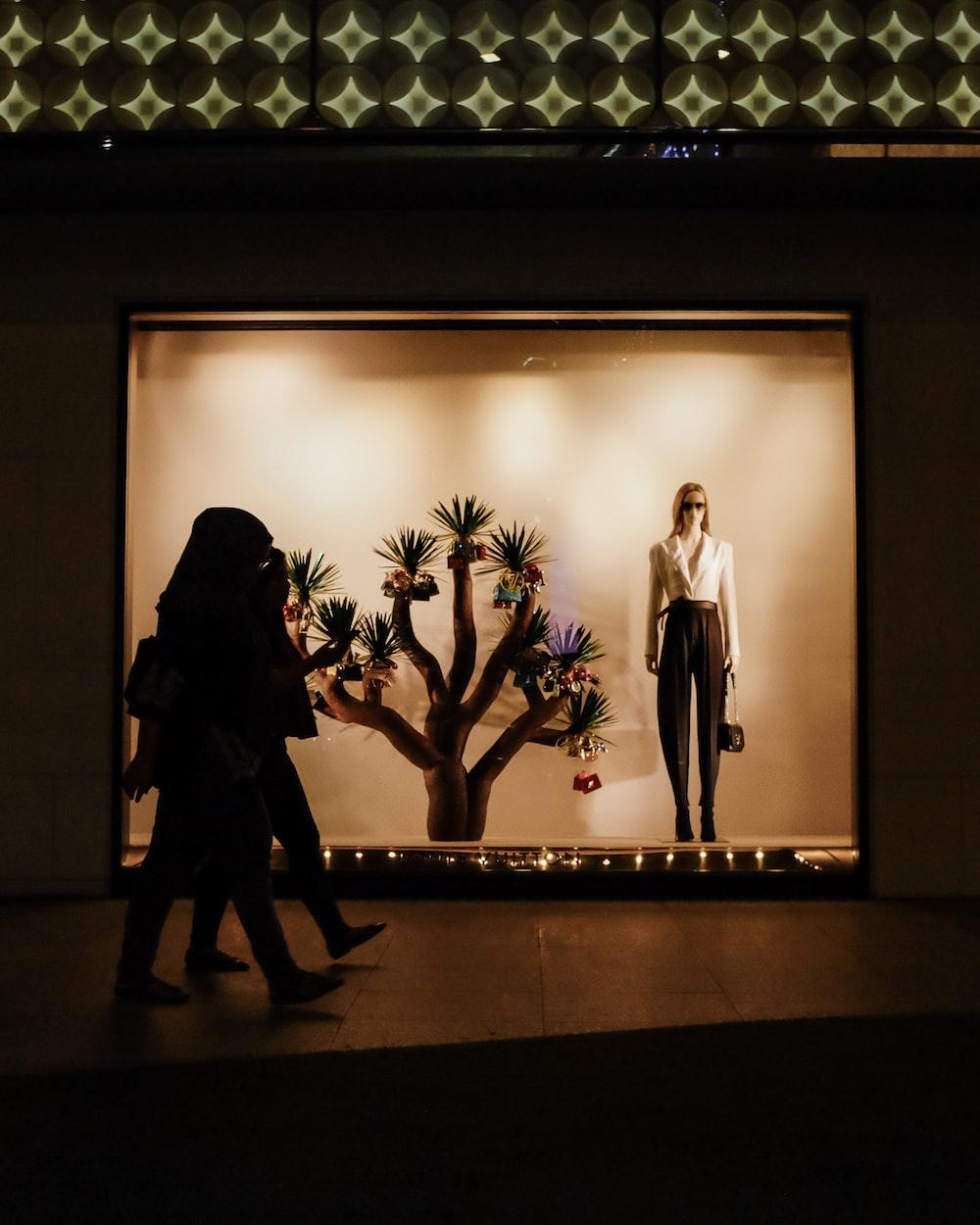 woman walking inside mall