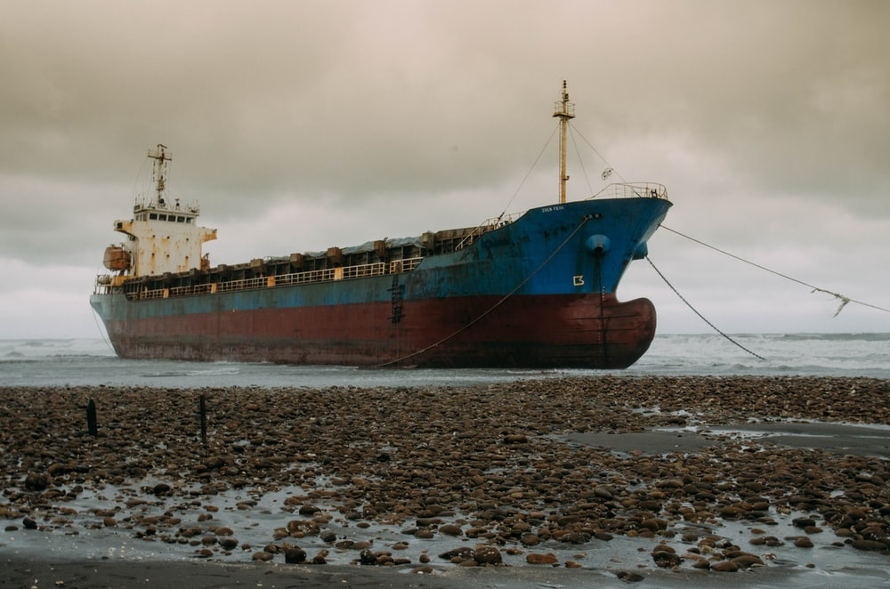 ship on shore during daytime