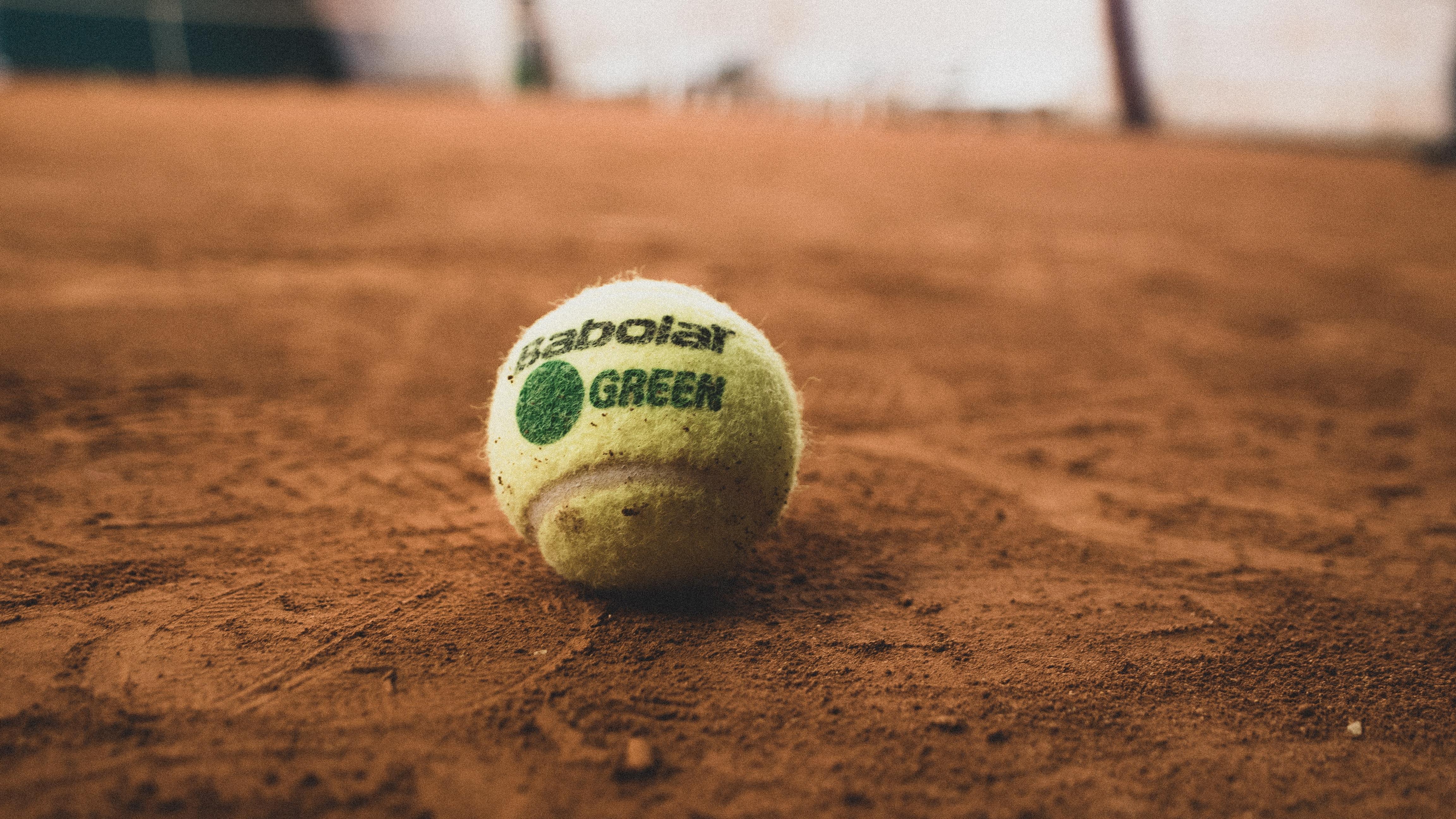 white and green baseball ball