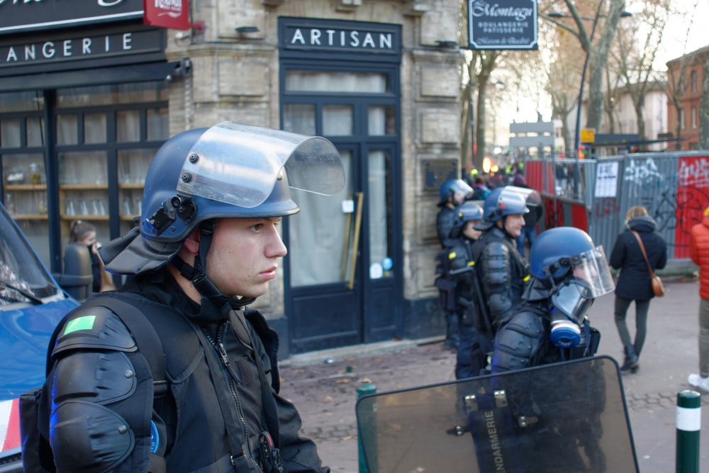 man wearing blue riot helmet