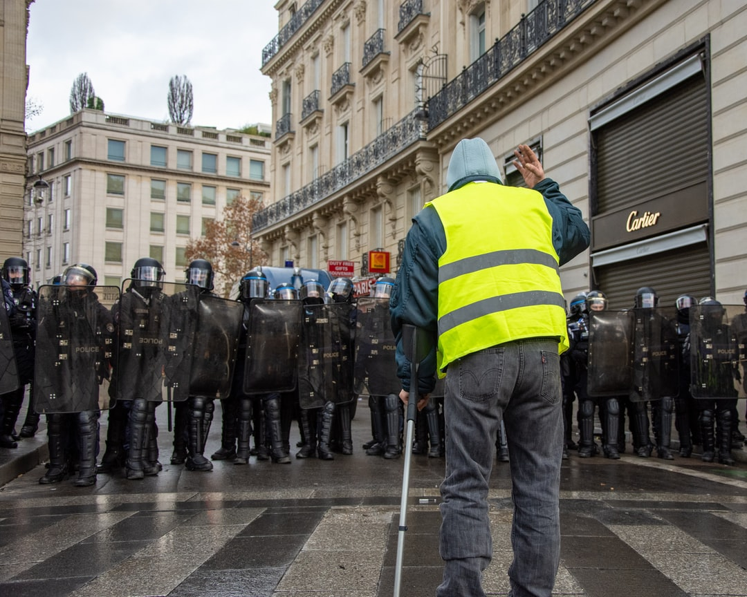 An old man from the Gilet Jaune movement shouts at the police during the protest on December 8th.