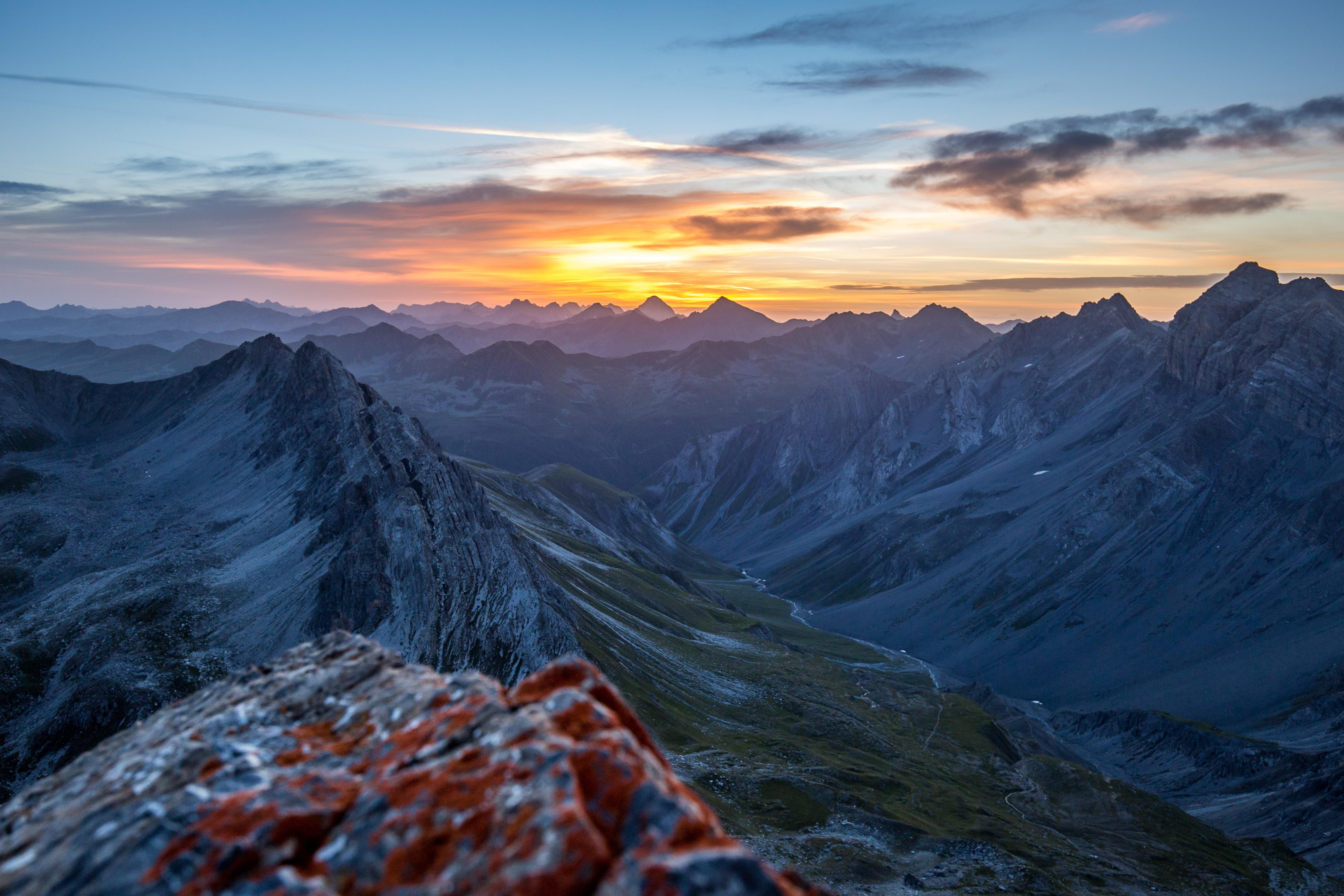 mountain top under sunset