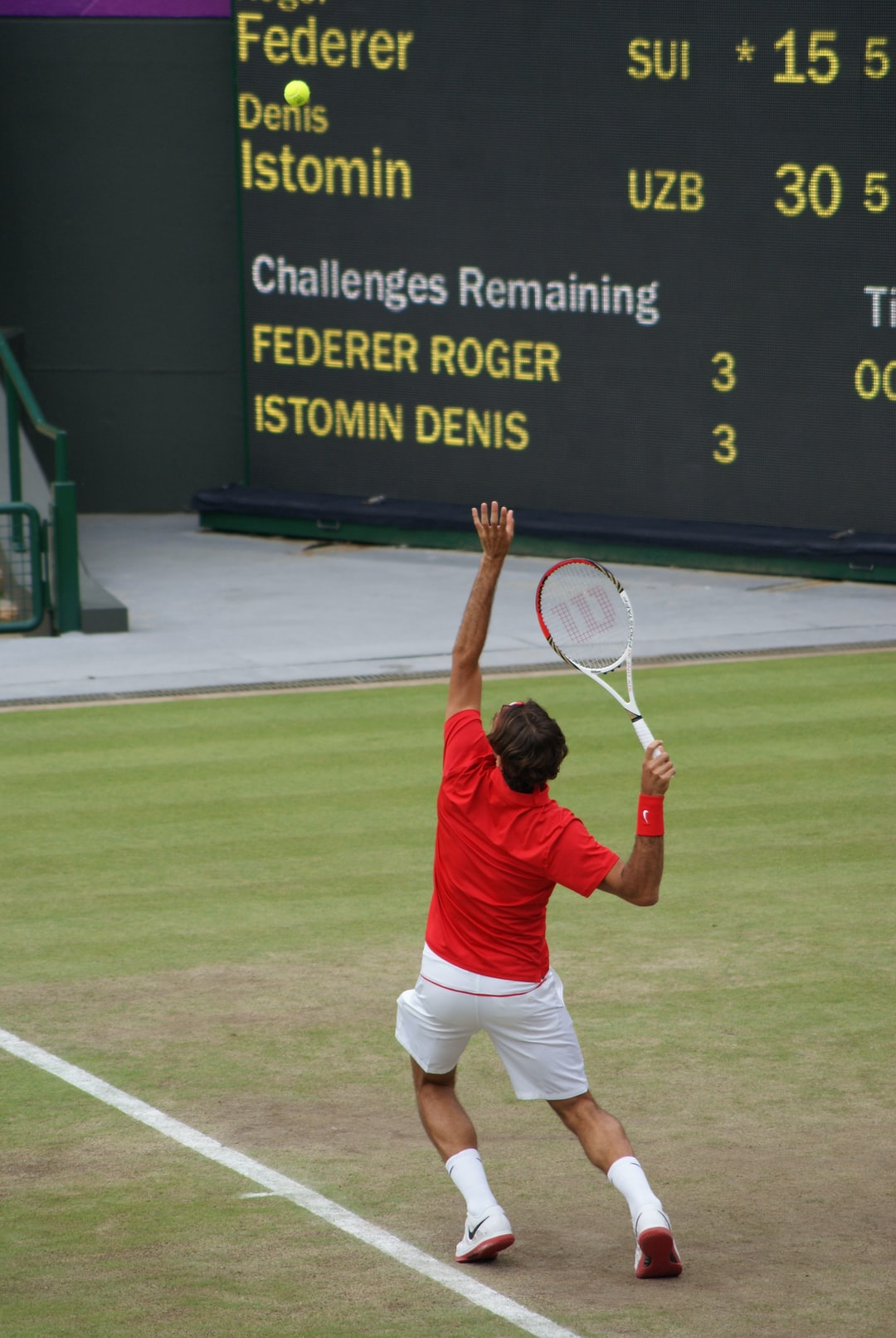 Roger Federer serving during one of his matches at the 2012 London Olympics.