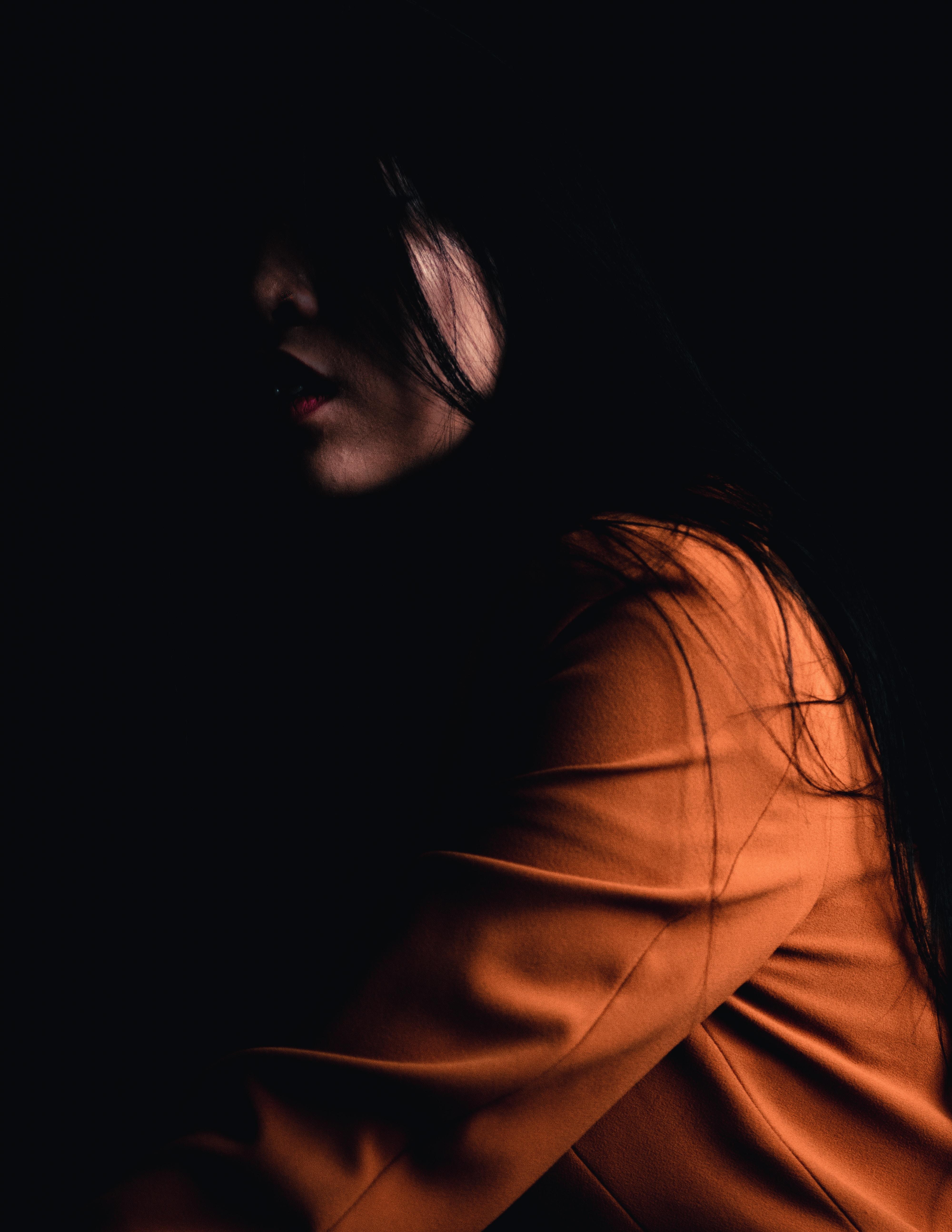woman wearing brown long-sleeved top