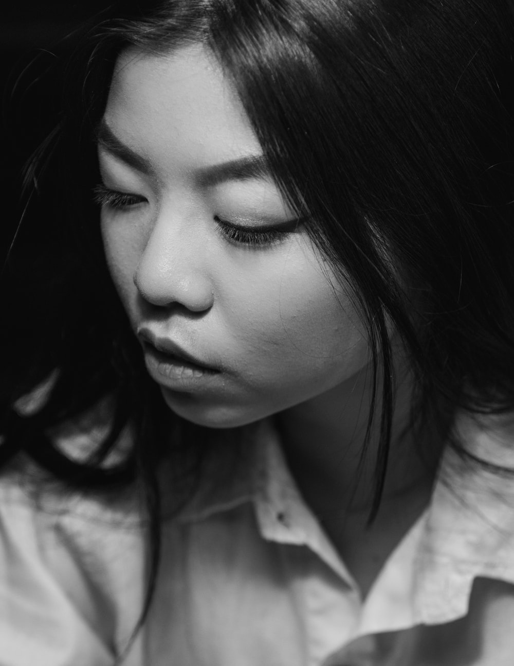 grayscale portrait photography of woman
