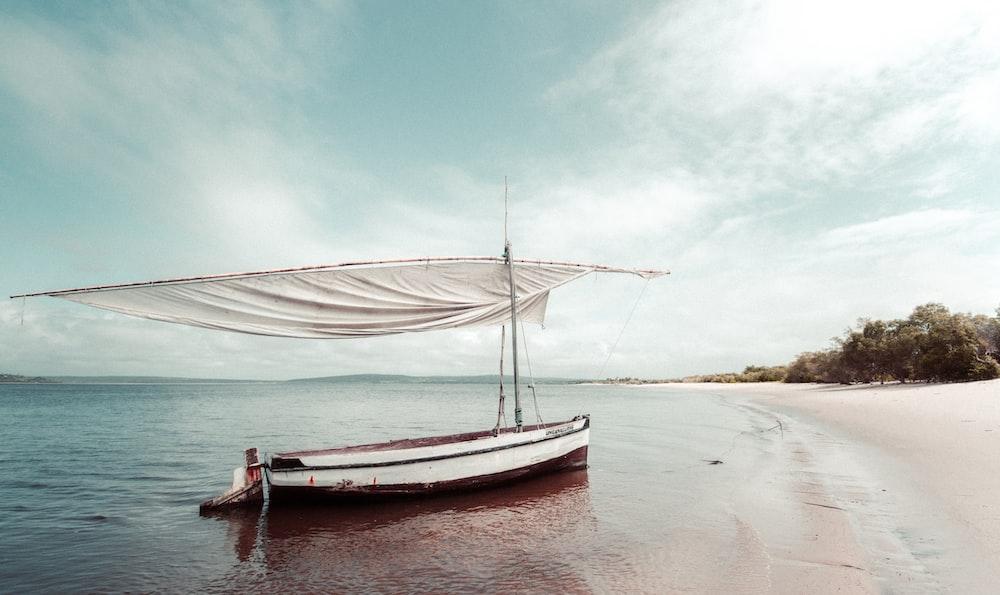 sailboat at shore during daytime
