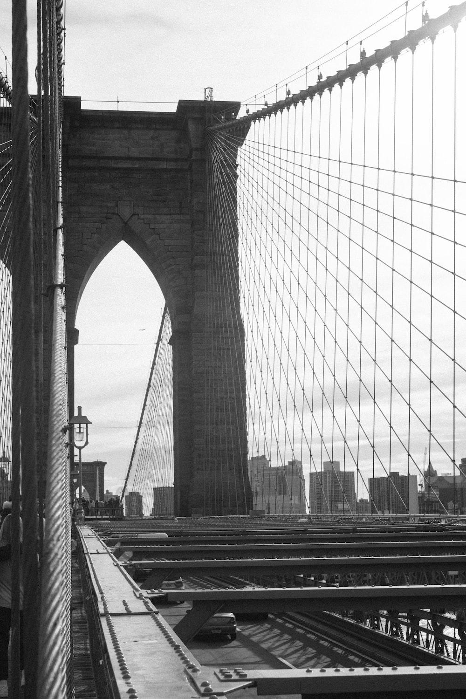 grayscale photography of Brooklyn Bridge