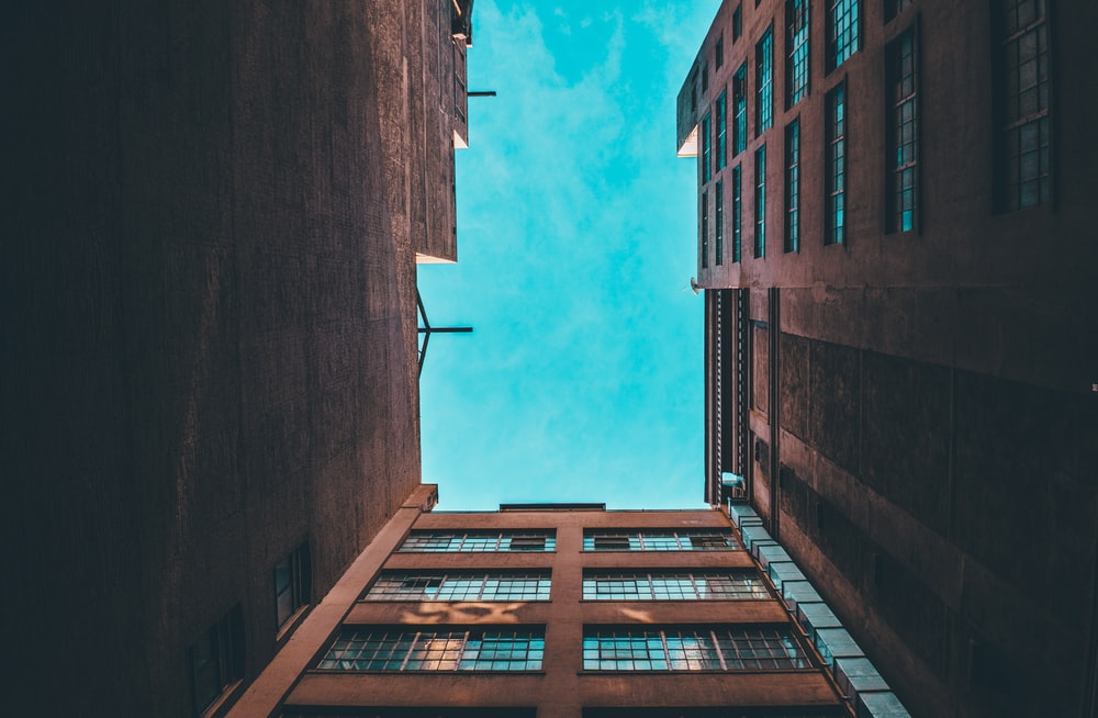 low-angle photography of brown concrete building