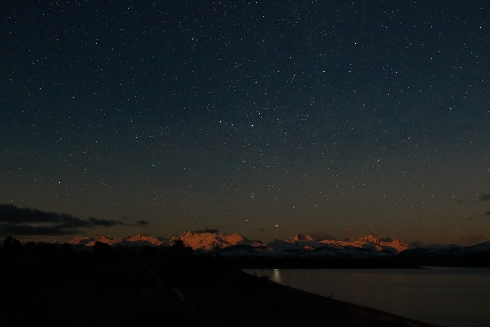 landscape photography of clear sky full of stars over mountains during night