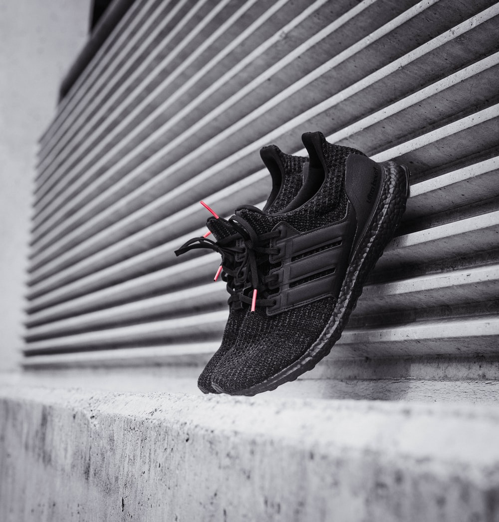 pair of black Adidas Ultra Boost shoes