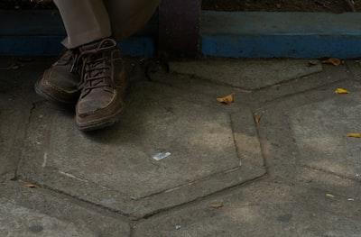 person wearing brown shoes el salvador teams background