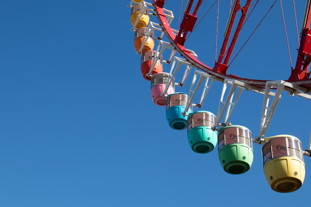 low-angle photography of multicolored Ferris-wheel