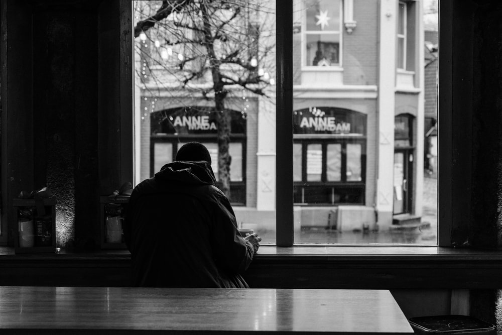 man sitting inside building during daytime