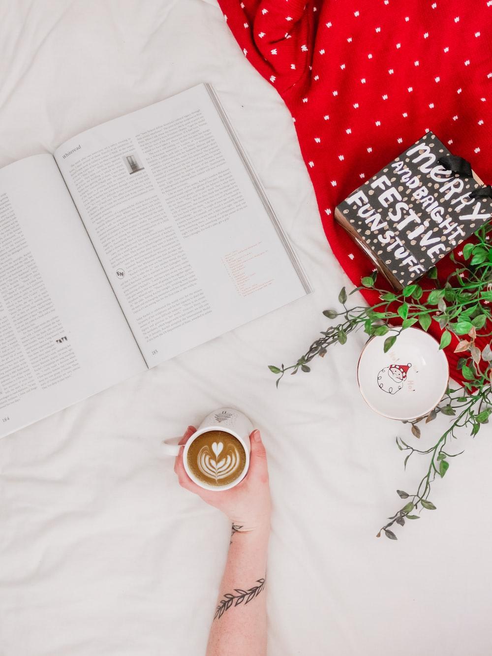 person holding mug of cappuccino