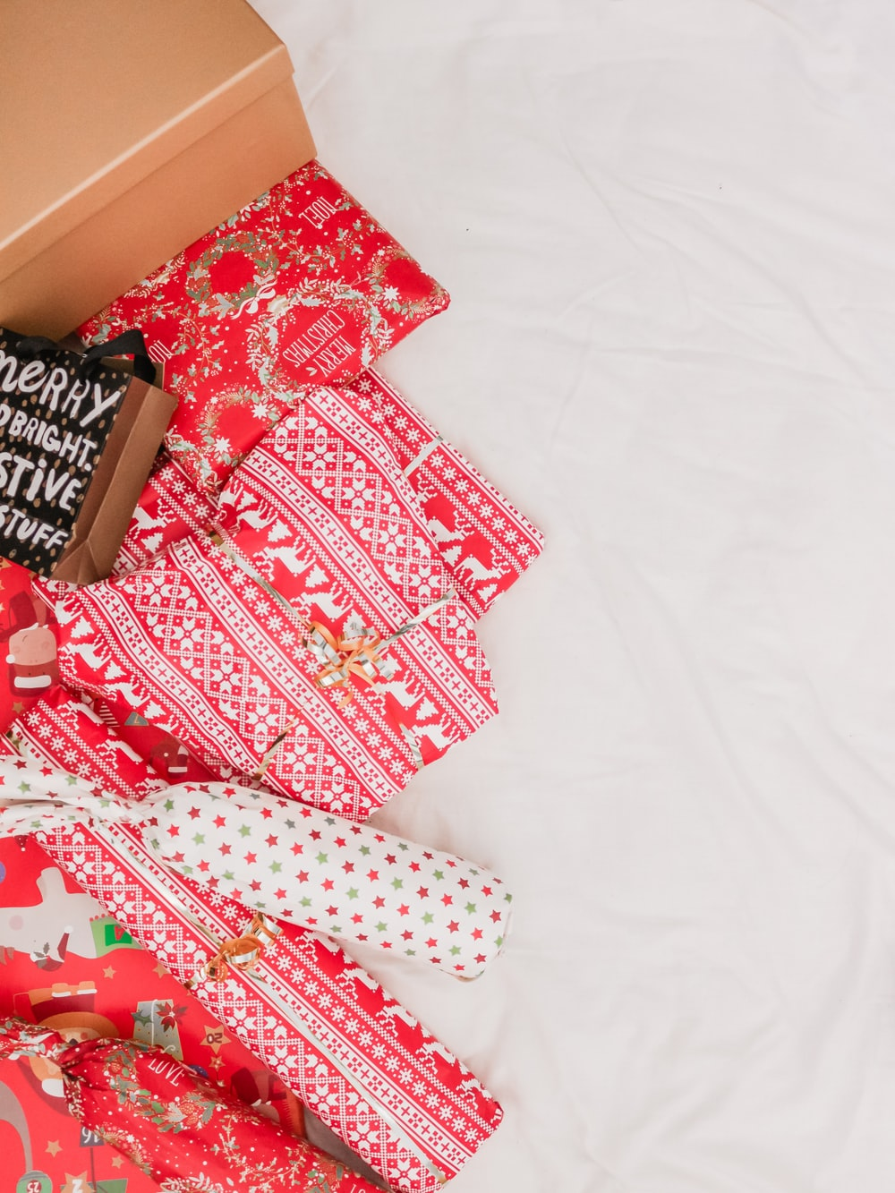 Christmas gifts on bed