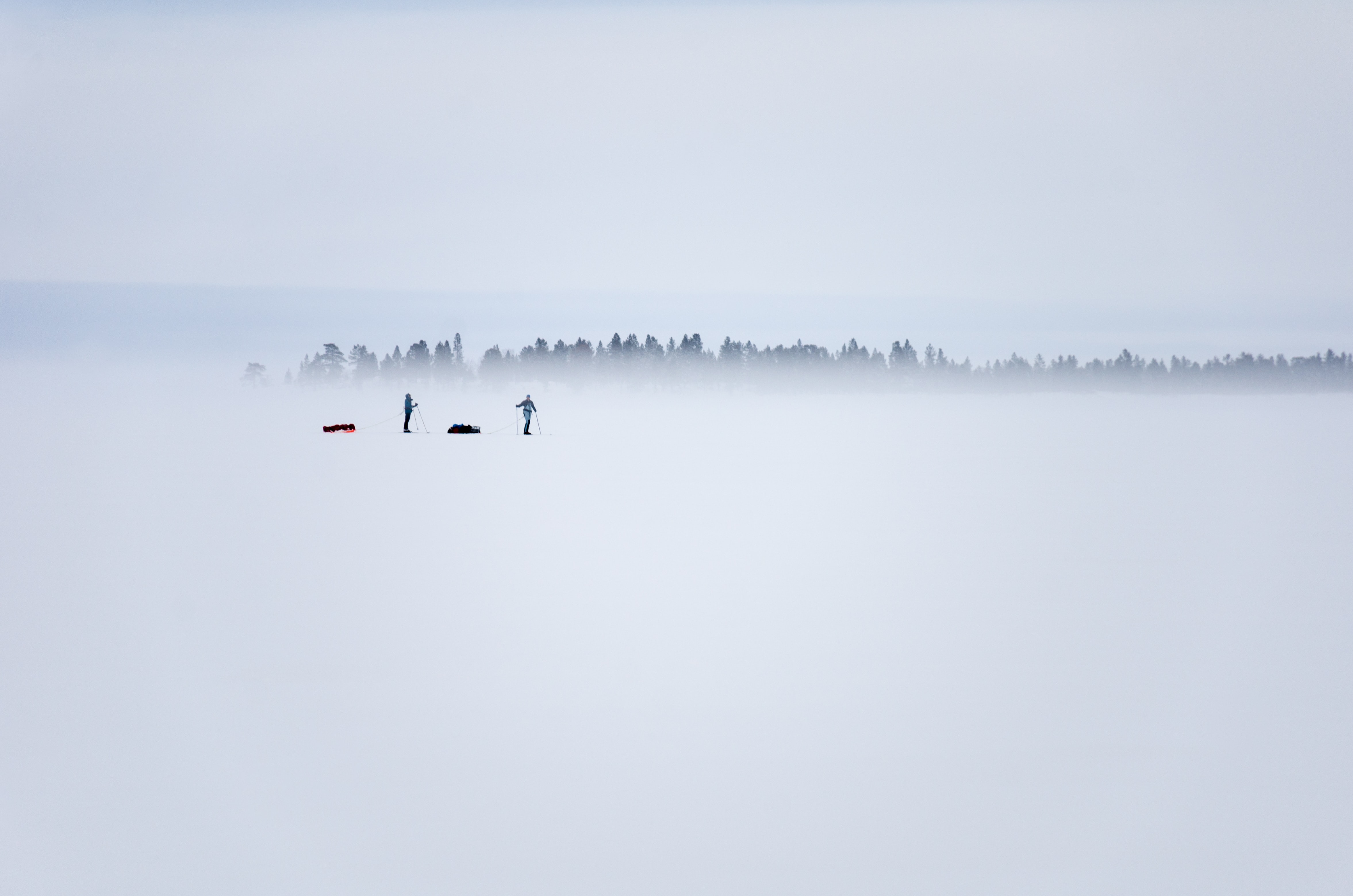 two persons standing on ice field